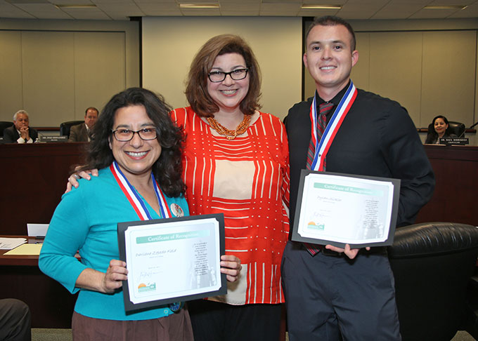 Board of Trustee Clerk Arianna P. Barrios (center) presents Darliene Zepeda (left) and Dylan Sickler with certificates
